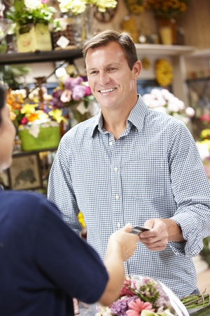 Man serving customer in florist photo