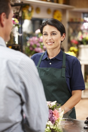 retailer: Woman serving customer in florist Stock Photo