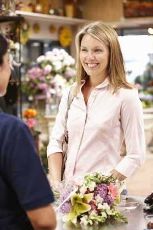 Woman shopping in florist photo