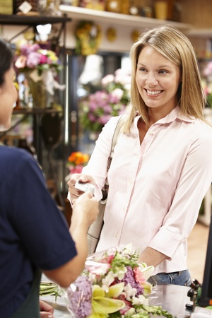 service card: Woman shopping in florist Stock Photo