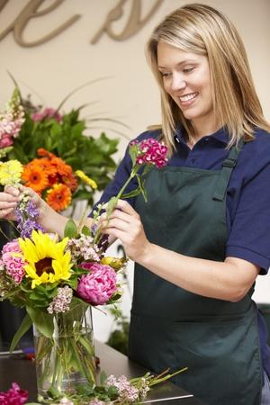 flower shop: Woman working in florist