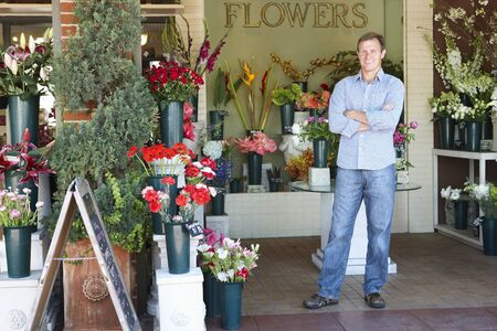 Man standing outside florist photo