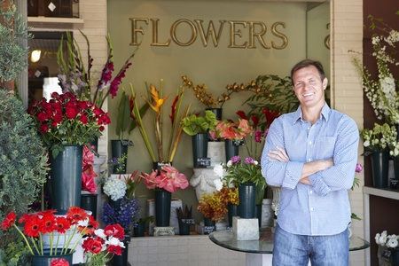 florist shop: Man standing outside florist Stock Photo