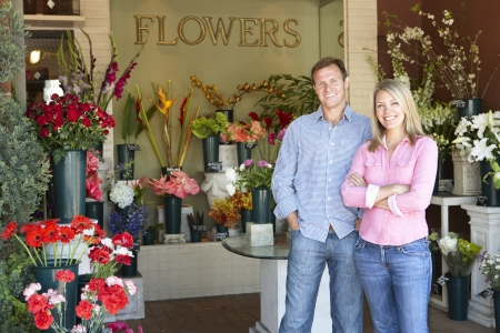 business owner: Couple standing outside florist