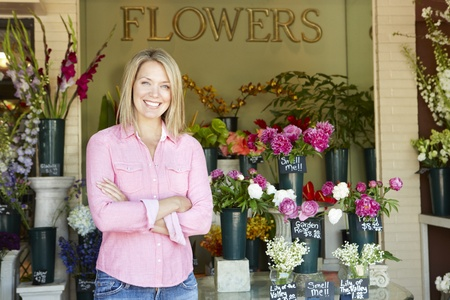 Woman standing outside florist Stock Photo - 11217513