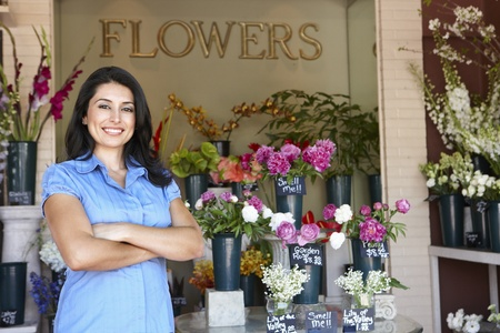 florist shop: Woman standing outside florist