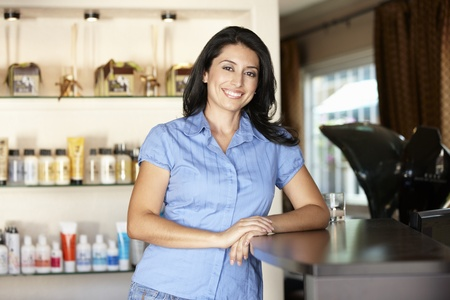 reception desk: Woman working in hairdressing salon Stock Photo