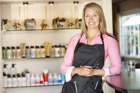 Woman working in hairdressing salon photo