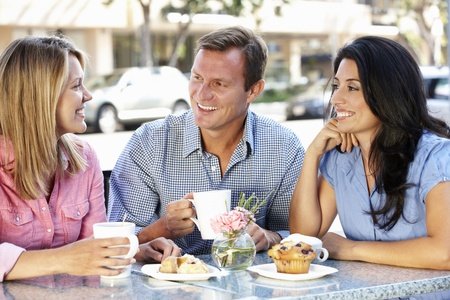 Friends chatting outside caf� Stock Photo - 11217516