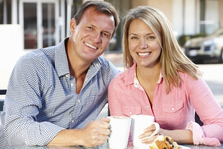 30s adult: Couple sitting at sidewalk caf�