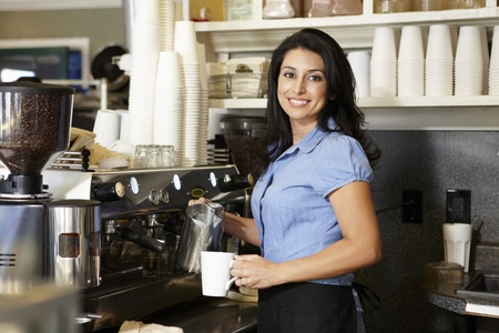 serving: Woman working in coffee shop Stock Photo