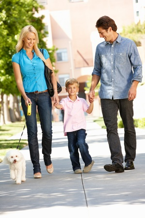 Family walking with dog in city street Stock Photo - 11217723