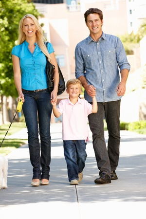 Family walking with dog in city street Stock Photo - 11217844
