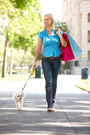 retail therapy: Woman on shopping trip with dog