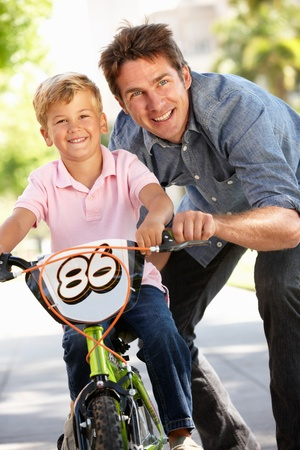 Father with boy on bike photo