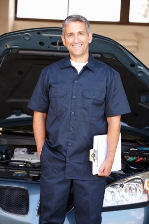 auto shop: Mechanic at work Stock Photo