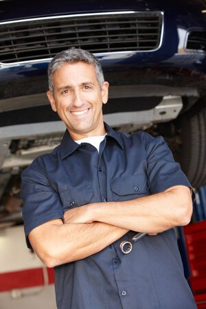 auto garage: Mechanic at work Stock Photo