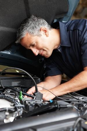 mechanic car: Mechanic at work Stock Photo