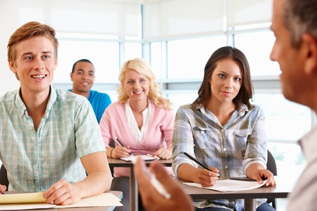 teaching and learning: Tutor with class of students