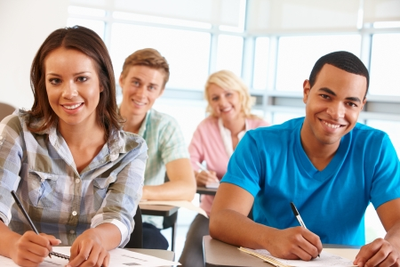 college classroom: Students working in classroom Stock Photo
