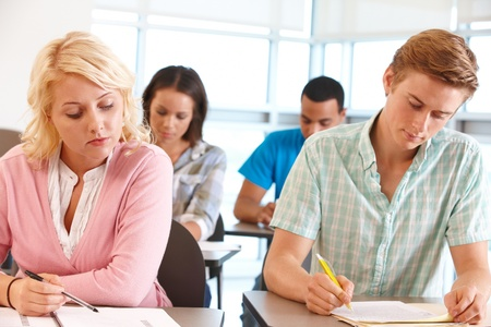 19 year old: Students working in classroom Stock Photo