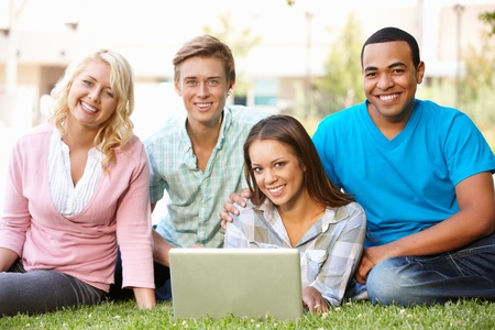 Young people using laptop outdoors photo