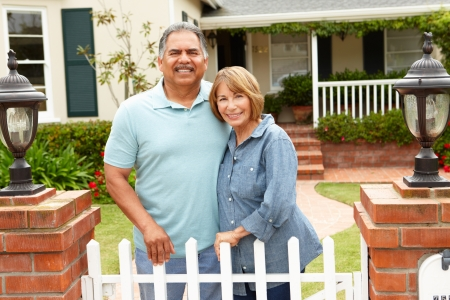Senior Hispanic couple outside home photo