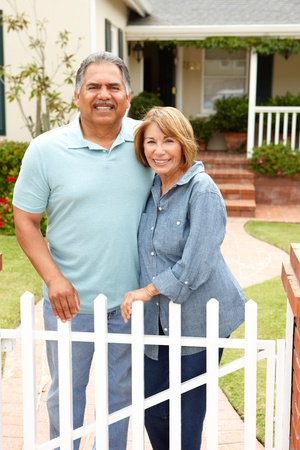 well maintained: Senior Hispanic couple outside home