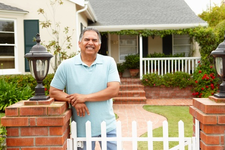 Senior Hispanic man outside home photo