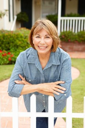Senior Hispanic woman outside home Stock Photo - 11217648