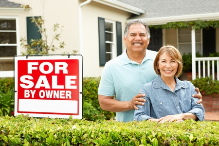 Senior Hispanic couple selling house Stock Photo - 11217727