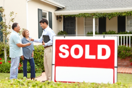 garden key: Senior Hispanic couple buying new home