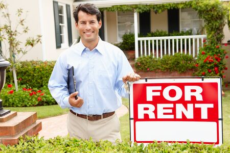 for rent sign: Real estate agent at work