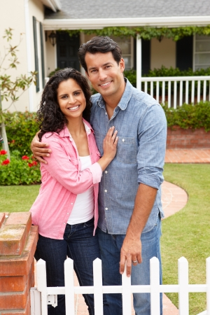 maintained: Hispanic couple outside home Stock Photo