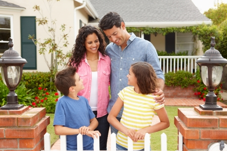 well maintained: Hispanic family outside home