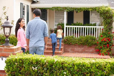 Hispanic family outside home for rent Stock Photo - 11217842