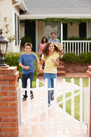 Hispanic family outside home Stock Photo - 11217733