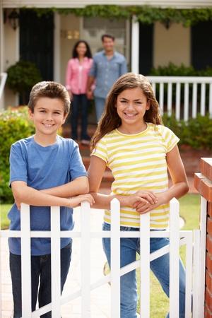 9 year old girl: Hispanic family outside home