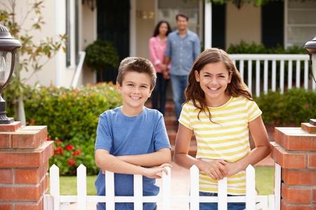 organized home: Hispanic family outside home