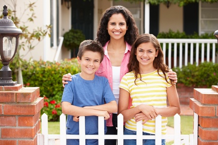 Mother and children outside home Stock Photo - 11217928