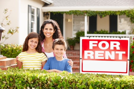 for rent: Mother and children outside home for rent Stock Photo