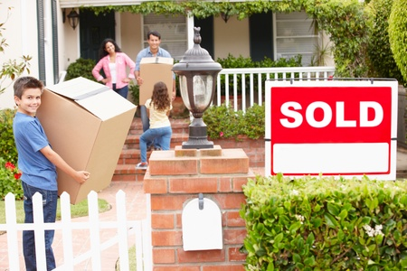 man carrying box: Family moving into new home Stock Photo