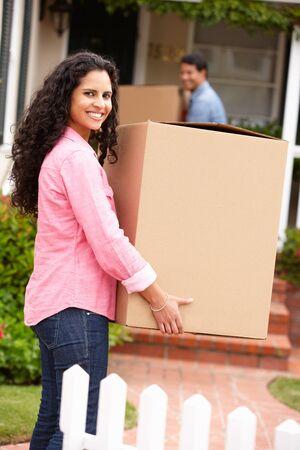 Hispanic couple moving into new house Stock Photo - 11217743