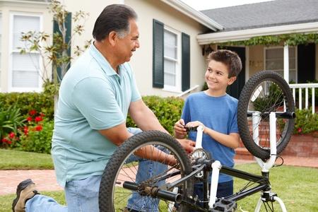 boy and grandfather fixing bike Stock Photo - 11218013