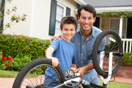Father and son fixing bike photo