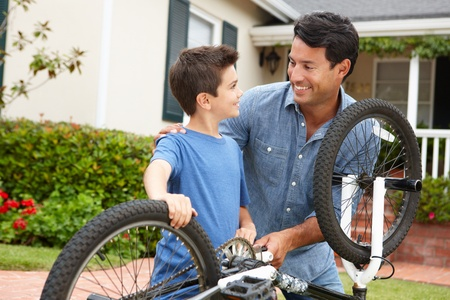 mend: Father and son fixing bike