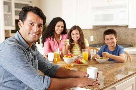 old people eating: Hispanic family eating breakfast Stock Photo
