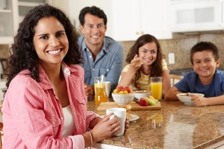 Hispanic family eating breakfast photo
