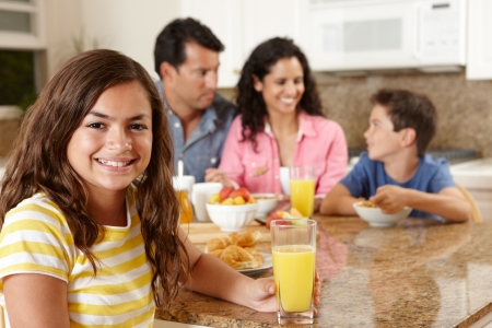 hispanic women: Hispanic family eating breakfast Stock Photo