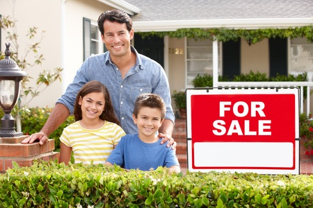 Father and children outside home for sale photo